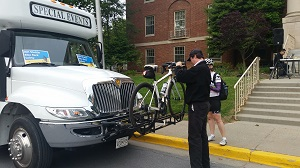Picture of bicycle being loaded onto a shuttle.