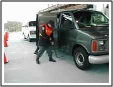 Guard screening a commercial vehicle